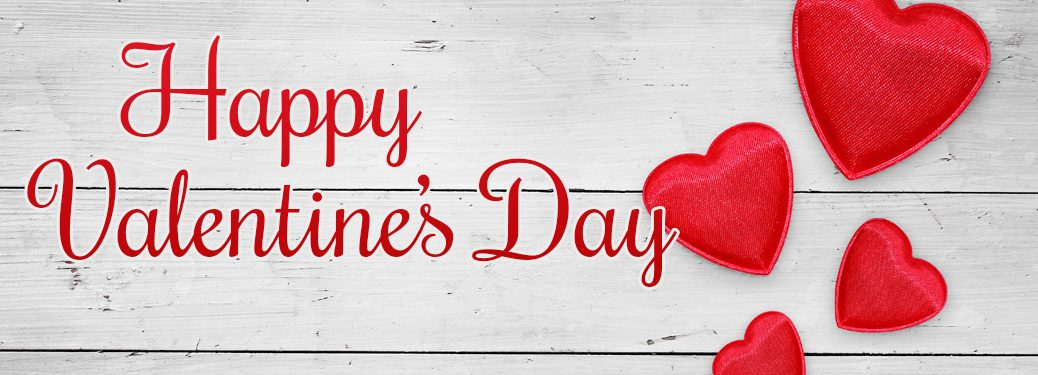 Happy Valentine's Day banner with hearts and red text over a white wooden background