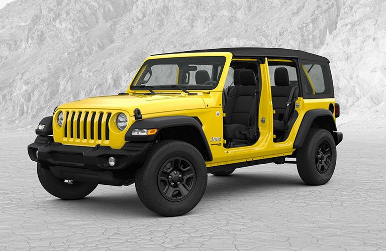 Yellow 2019 Jeep Wrangler Unlimited with no doors in an Arctic wasteland.