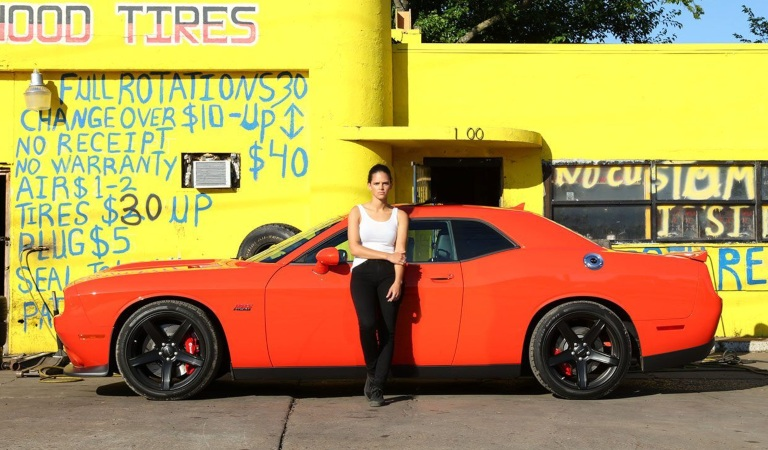 2019 Dodge Challenger red side view woman leaning on the door