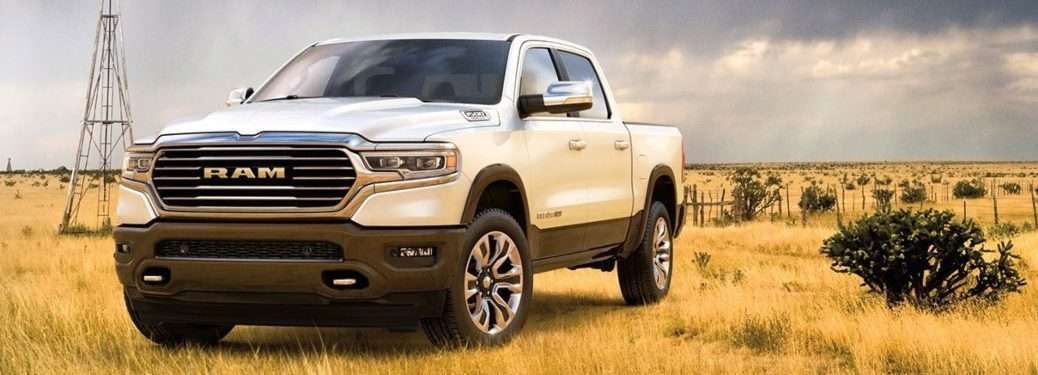 2020 RAM 1500 white front side view in a field