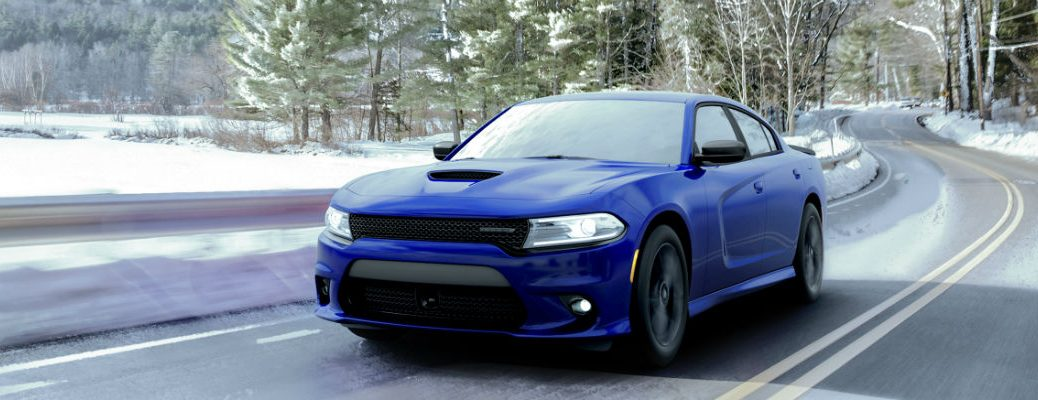 Blue 2020 Dodge Charger on snowy road