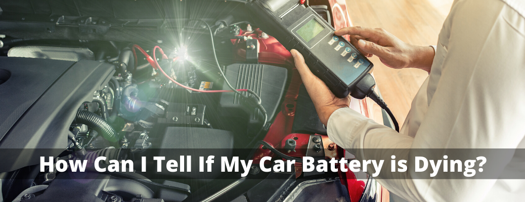 "Mechanic checking battery with ""How Can I Tell If My Car Battery is Dying?"" white text"