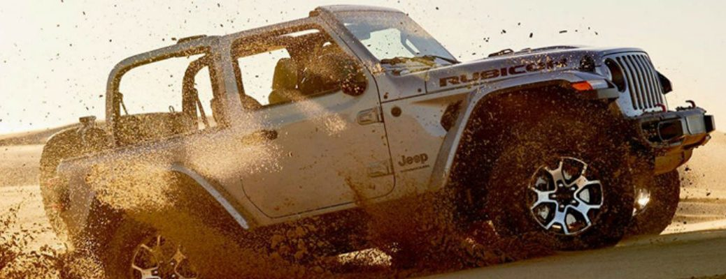 2020 Jeep Wrangler driving through dirt