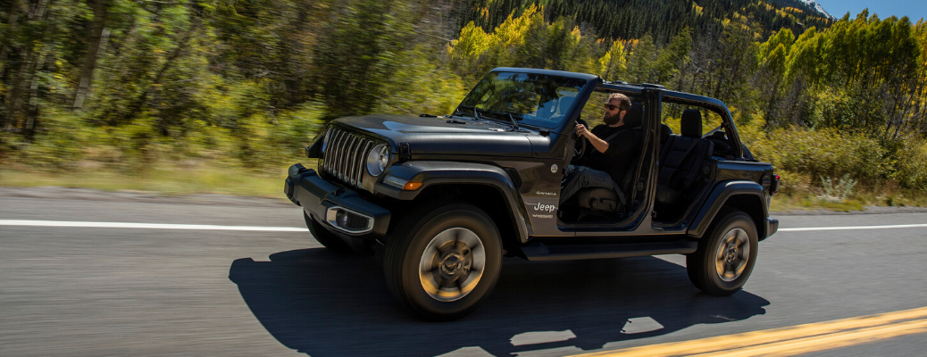 Grey 2020 Jeep Wrangler driving with doors off