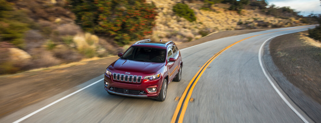 Overhead view of red 2020 Jeep Cherokee driving