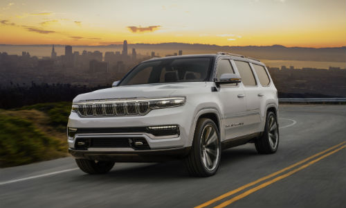 White Jeep Grand Wagoneer Concept driving