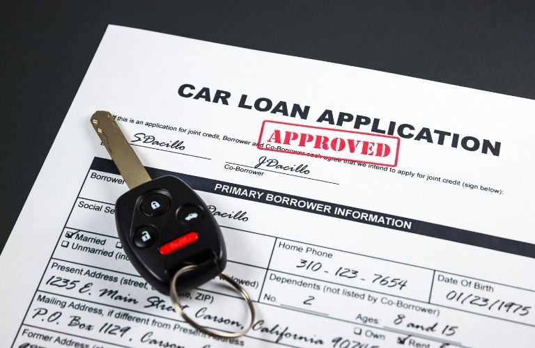 Car key and approved car loan application form