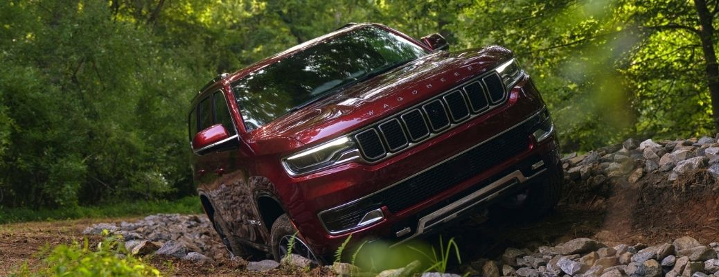 The 2022 Jeep Wagoneer making its way through the woods