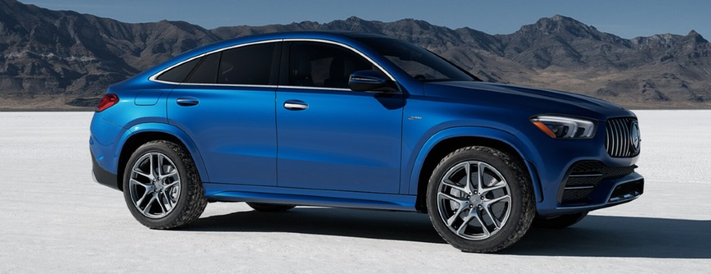 2021 MB GLE AMG 53 Coupe blue exterior passenger side parked in desert type area with mountains in background