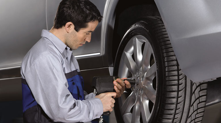 Mercedes-Benz service technician working on wheels