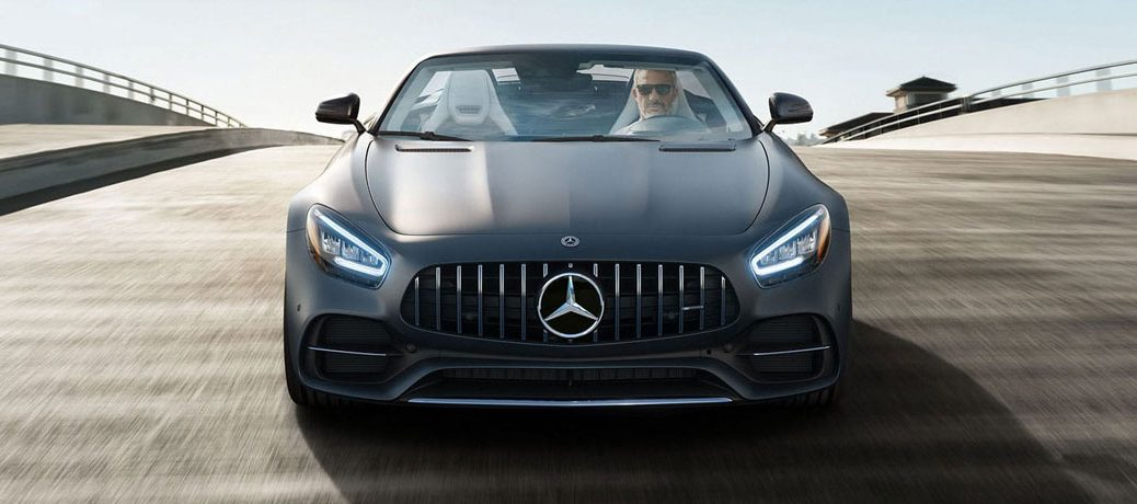 Head-on view of a black 2020 Mercedes-Benz AMG GT Roadster driving up a highway