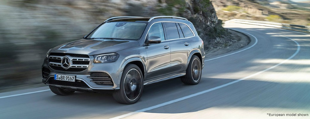 2020 MB GLS SUV European Model silver exterior front driver side driving around a curvy road
