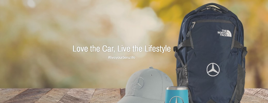 Mercedes-Benz lifestyle items on wooden table with love the car live the lifestyle slogan