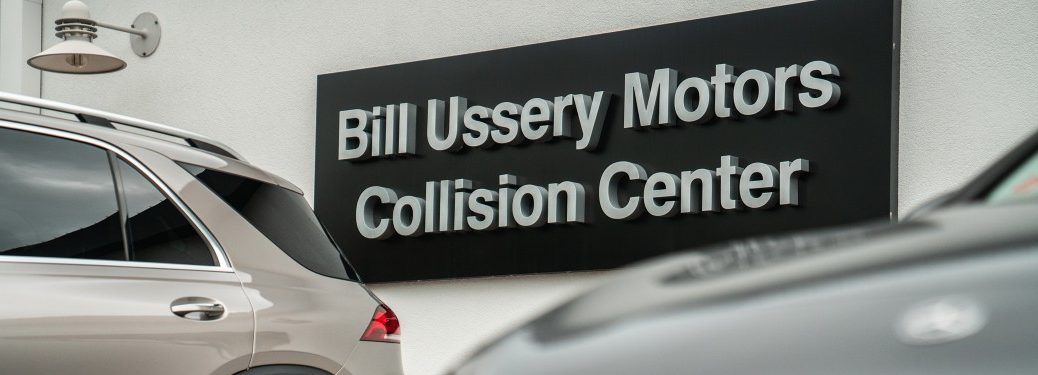 models parked outside of bill ussery motors collision center