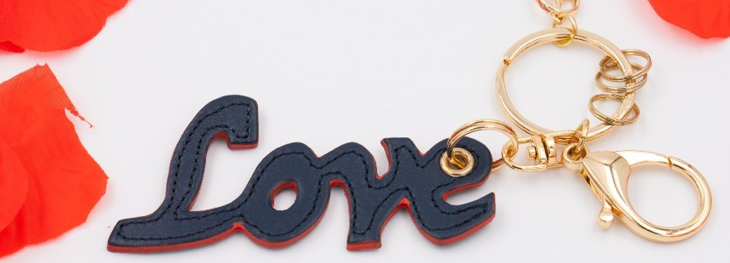 love keychain surrounded by rose petals coral gables