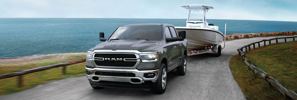 2020 RAM 1500 towing a boat near a body of water