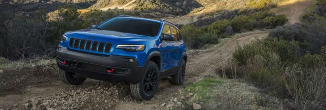 2020 Jeep Cherokee driving over a mountain