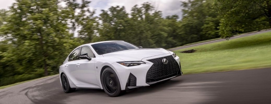 A white 2021 Lexus IS 350 Sport on the road