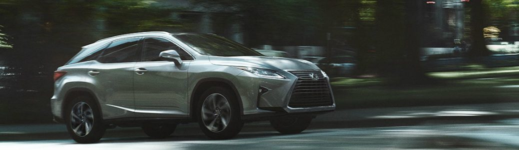 2019 Lexus RX driving down the road
