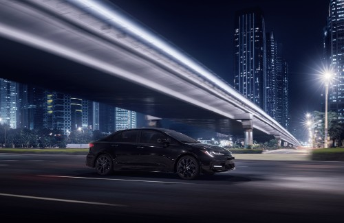 Corolla SE Nightshade in Black Shade Pearl driving in city at night