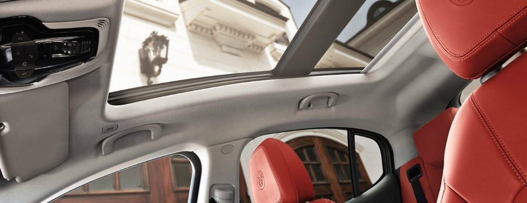 2019 Alfa Romeo Stelvio interior shot showing red sport leather seating upholstery and panoramic sunroof