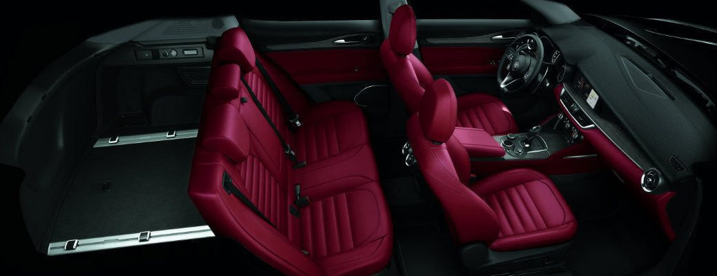 2019 Alfa Romeo Stelvio interior overhead shot of 2-row seating upholstery and cargo space displaying total cabin volume