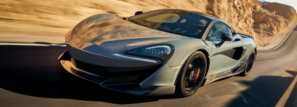 Light blue McLaren 600LT driving on a hilly road
