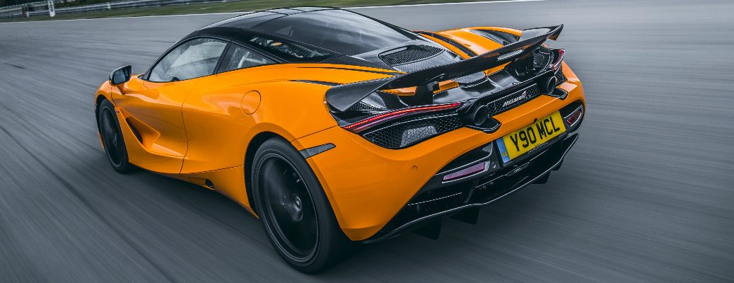 Rear view of orange McLaren 720S with a MSO Defined Carbon Fiber Rear Active Spoiler