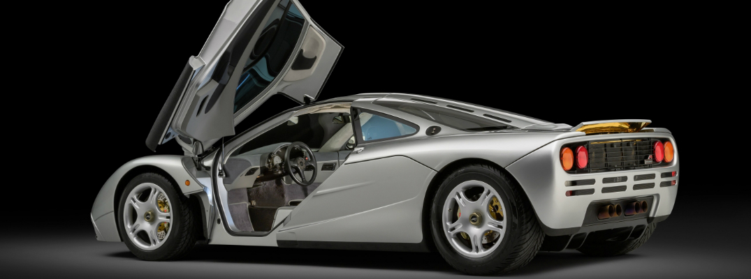 Rear view of restored silver McLaren F1 with butterfly doors opened
