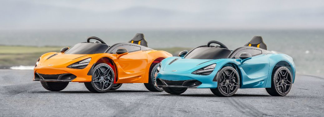 Two McLaren 720S Children's Ride-On cars parked on a racetrack