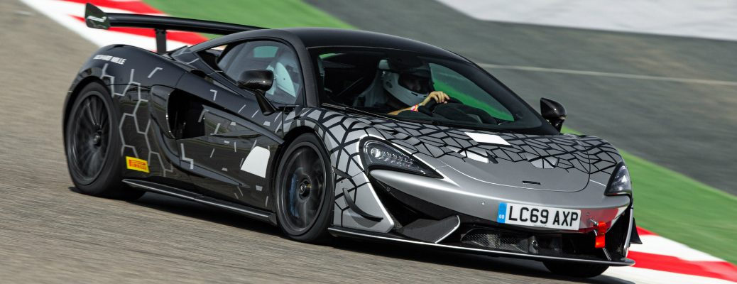 Silver and black 2021 McLaren 620R driving on a racetrack