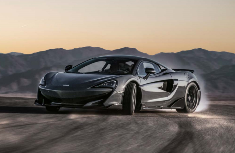 Front view of grey 2020 McLaren 600LT with mountains in the background