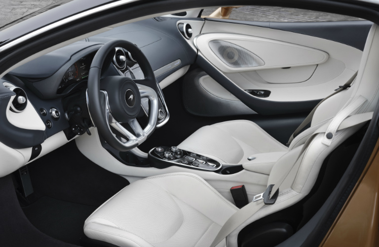 Grey and white dashboard and white seats in 2020 McLaren GT