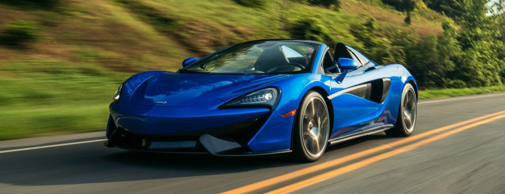 Driver's side front angle view of blue 2019 McLaren 570S Spider