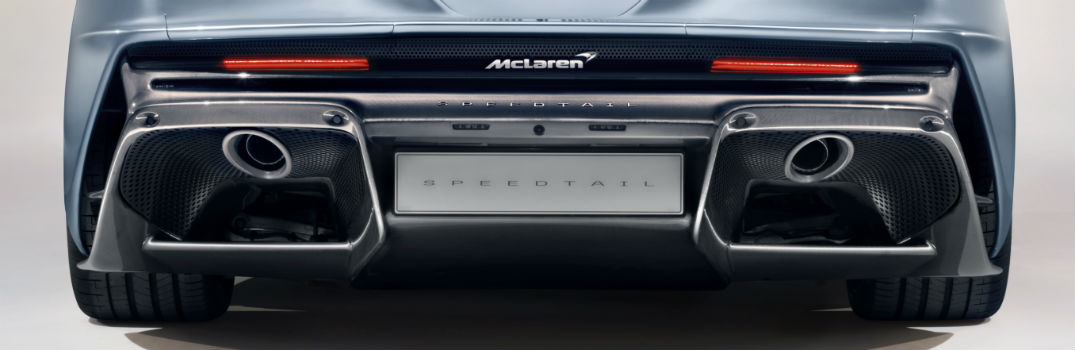How does McLaren Automotive use innovative materials in their exhaust systems?