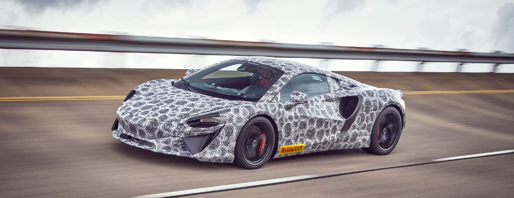 McLaren future hybrid supercar with hidden exterior pattern driving on track