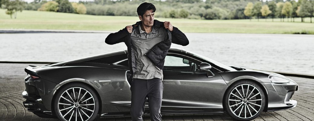 man wearing Castore and McLaren Auto new sportswear line walking away from McLaren model