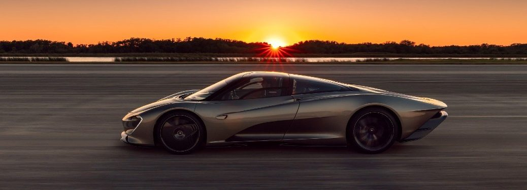 McLaren Speedtail driver side facing driving on track at sunset