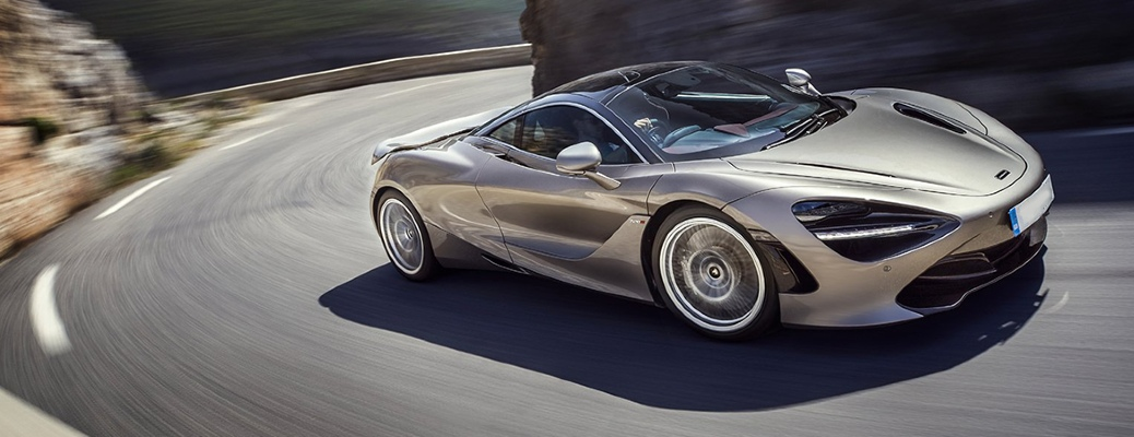 2021 McLaren 720S cruising up a curved road