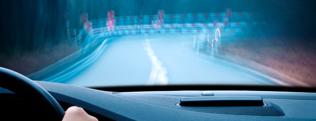 First-person view of an individual approaching a curve in a vehicle