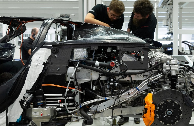 Some people work on building a McLaren vehicle