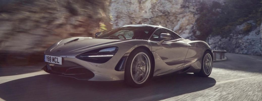 McLaren 720s coupe driving on a mountain road