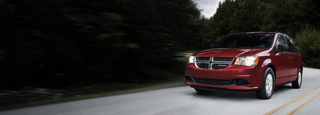 2020 Dodge Grand Caravan driving through wooded area