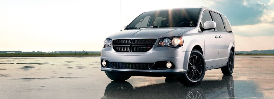 2020 Dodge Grand Caravan with clouds behind it