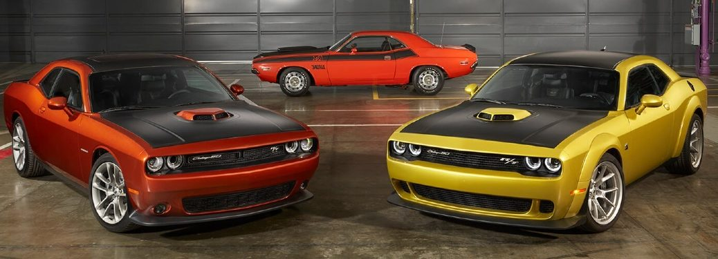 Three 2020 Dodge Challenger cars parked