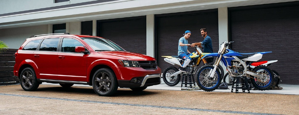 2020 Dodge Journey with motorcycles and men in front of it