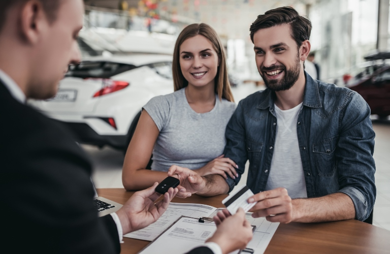 Couple at a dealership