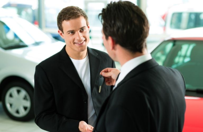 Customer Trading in a Car at a dealership to the salesperson