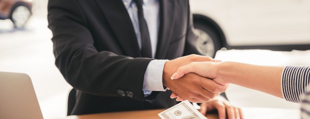 Sell or Trade-In Deal Handshake