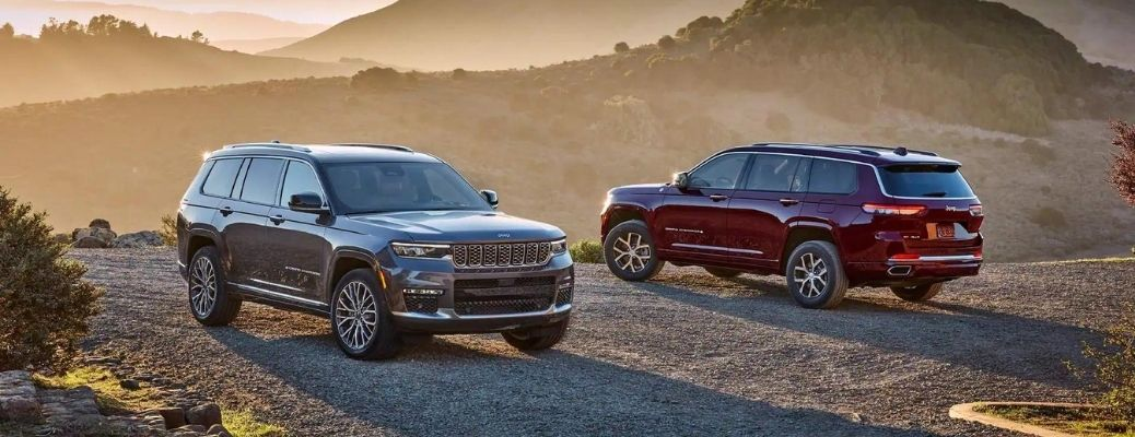 Two 2021 Jeep Grand Cherokee L vehicles standing side-by-side